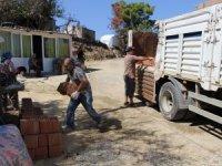 Büyükşehir'den yangın mağduru ailelere inşaat malzemesi desteği